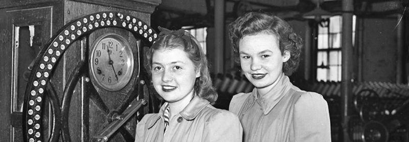 Betty Garside and Betty Roscoe at the check-in clock